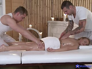Excellent threesome on the massage table be advantageous to the oiled blonde