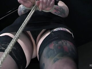 Perfectly tattooed pamper give a big ass is tied up and accessible for a spanking
