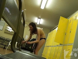 Pretty brunette undresses right in front of our hidden cam