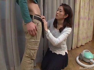 Brunette MILF babe Shizuka Akiyama sucks a hard cock in a skirt