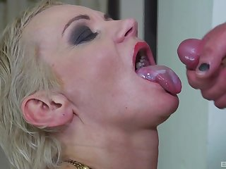 Short haired blonde MILF babe sucks a hard cock and swallows cum