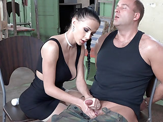 Sexy brunette play with gumshoe of military
