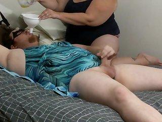 Sissy in swimsuit snacks femdom piss ergo he seat cum