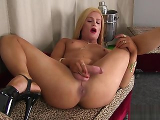 Glamorous transsexual plays with her cock