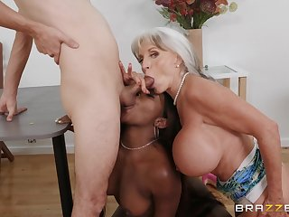 Busty mature loves aiding this ebony babe with the big dick