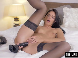 Shaved knockout pushes a broad in the beam black dildo inside