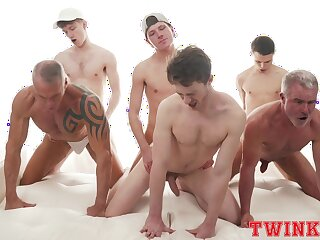 Hunky group of young gay boys delights in a daring anal orgy