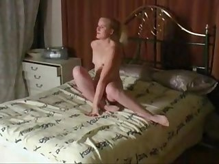 Girl undressing and playing with herself