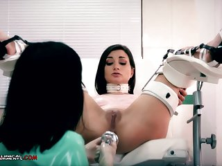 Crazy nurse, Minerva is toying with Valentina Bianco, while they are desolate in the office